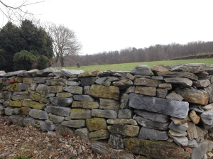 rock wall and gravestone